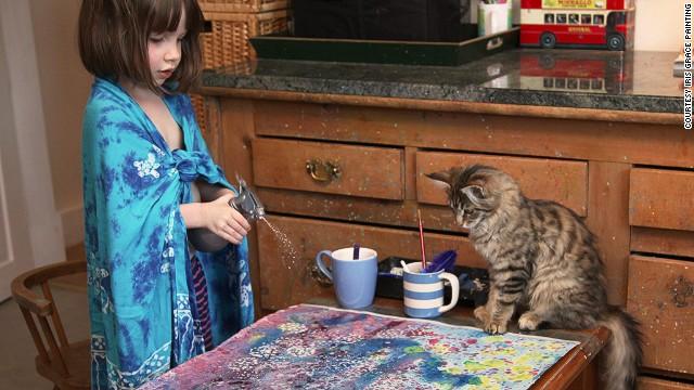 141009111118-iris-grace-painting-with-cat-2-horizontal-gallery