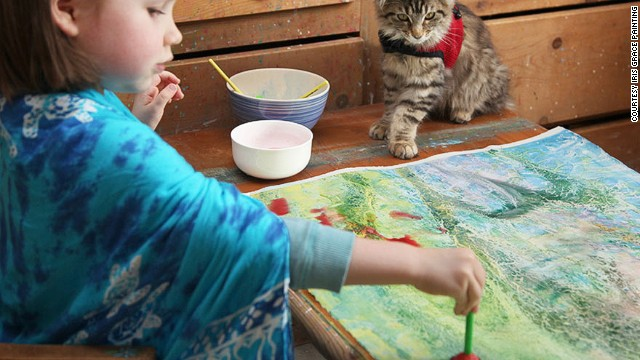 141009112810-iris-grace-with-painting-with-cat-3-horizontal-gallery